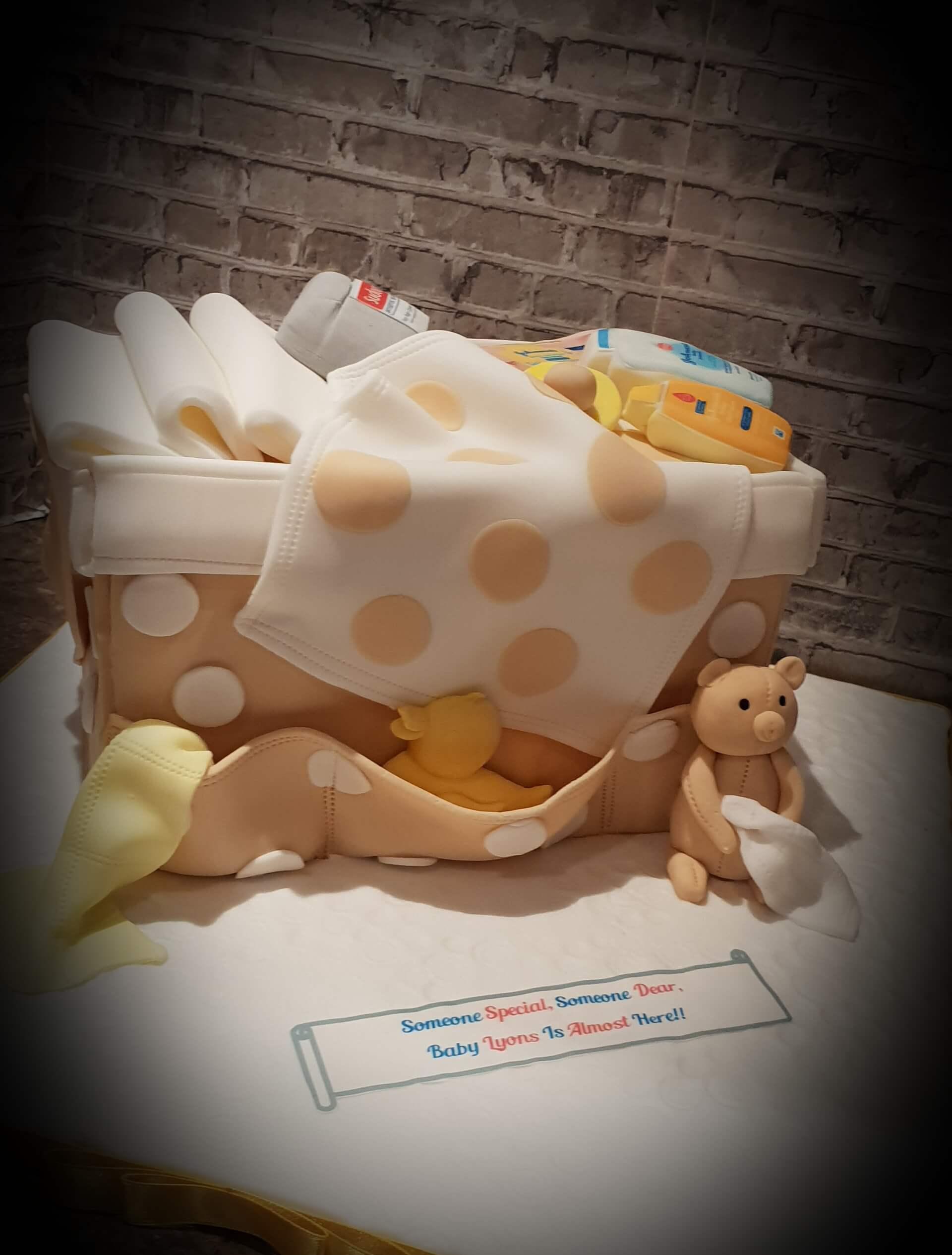 Baby arrival hamper cake