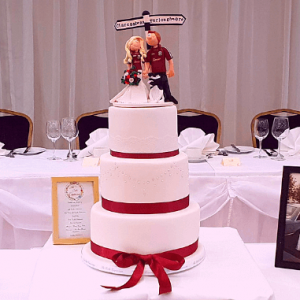 wedding cakes galway showing couple in GAA colours